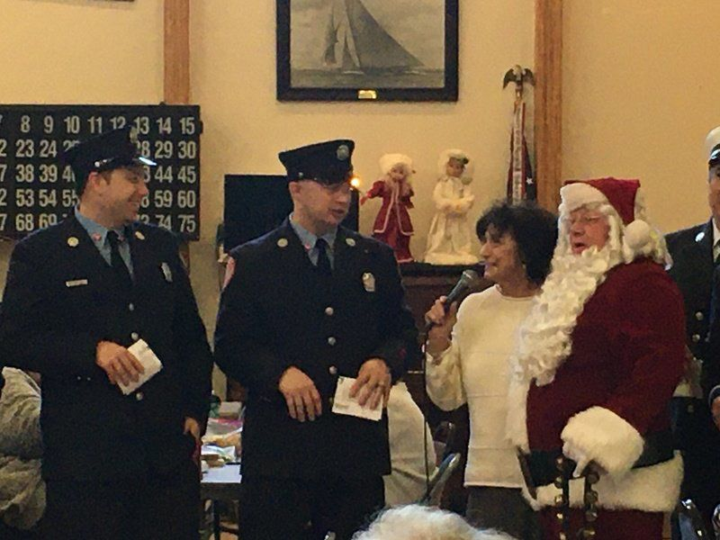 Firefighters serenade city with holiday favorites