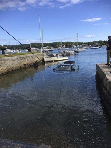 SUV rolls down ramp, into sea