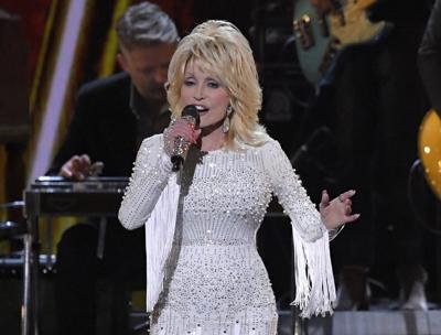 Dolly Parton adds pandemic hero to list of accomplishments