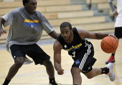 e152a5a8c84 New Orleans Hornets guard Chris Paul, right, works out against Quincy  Pondexter, left, during the first day of NBA basketball training camp.