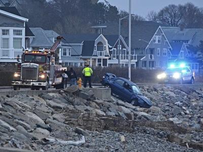 Man faces charges after driving car off the wall, onto the rocks