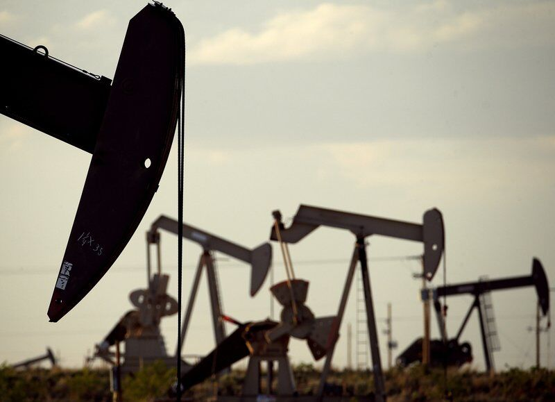 Oil companies lock in drilling, challenging Biden on climate