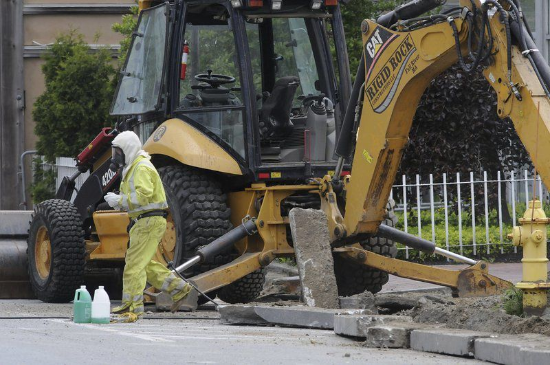 Businesses evacuated after gas line hit