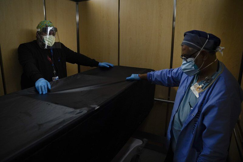 US tops 500,000 virus deaths, matching the toll of 3 wars