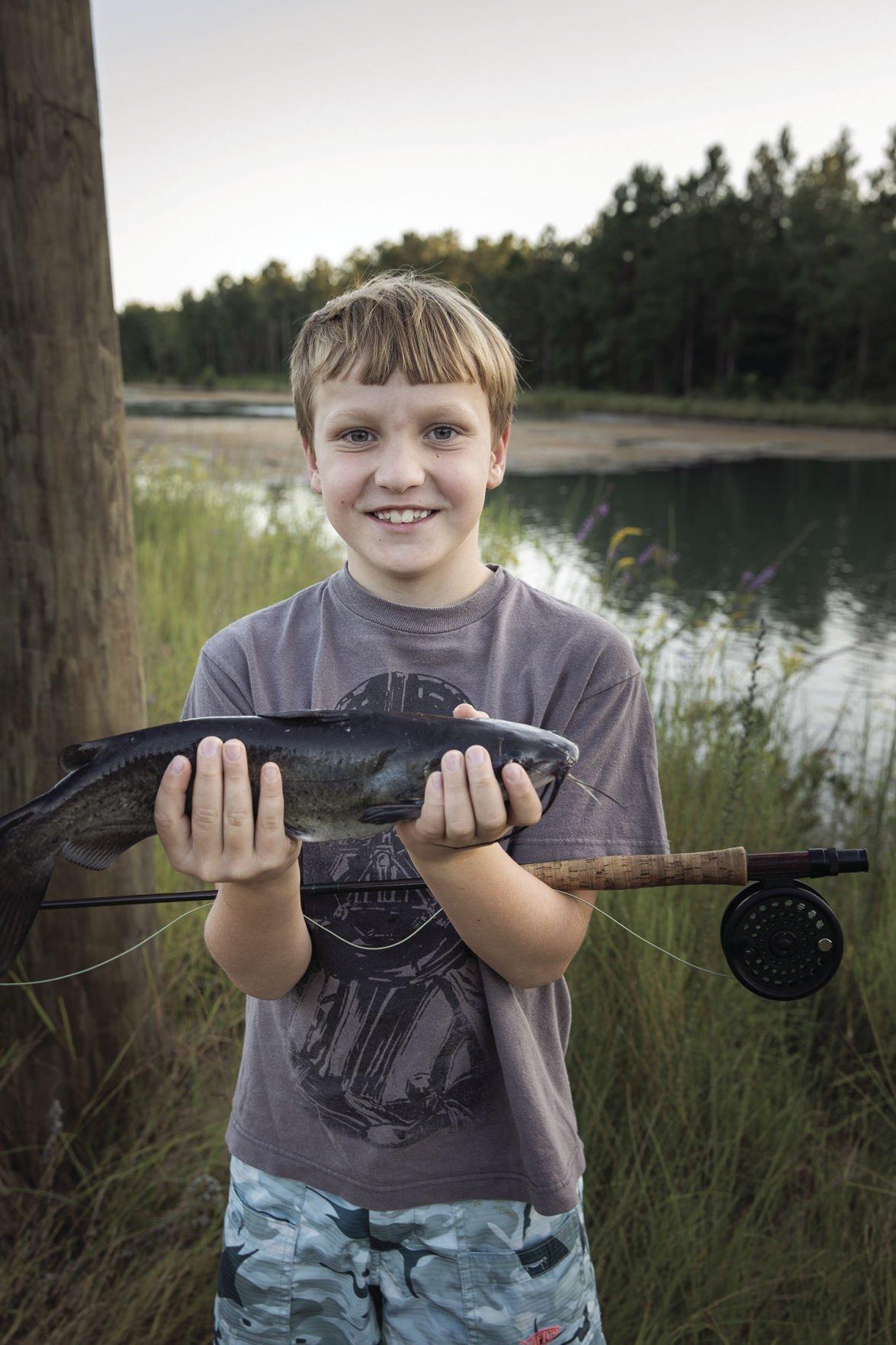 Boy Holding Fish 1_CMYK.jpg