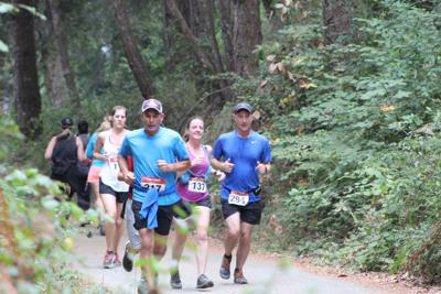 Runners race through Henry Cowell Redwoods State Park
