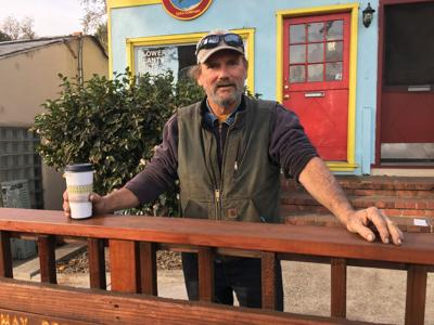 Ron Trader stands in front of the newly repaired Felton Community Deck