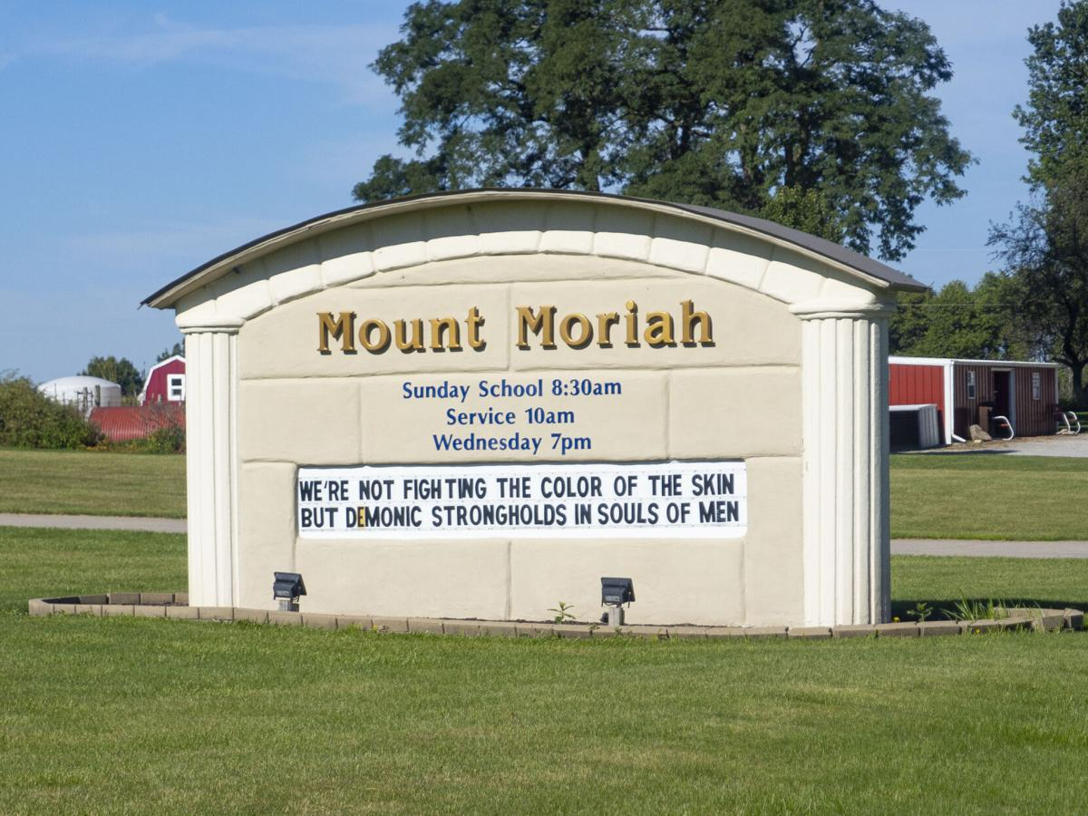 Local church's sign stirs racism controversy; woman takes action
