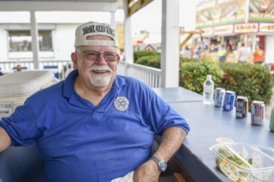 FAIR FACES: Exchange Club member enjoys raising money at the fair