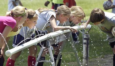 Reports outline how rising heat, summer droughts and spring rains will change Indiana