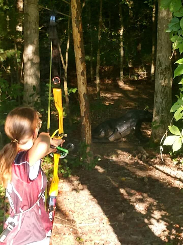 Emily Clouse WN archery shooting