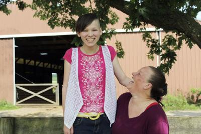 Goshen girl takes on calf project as final wish