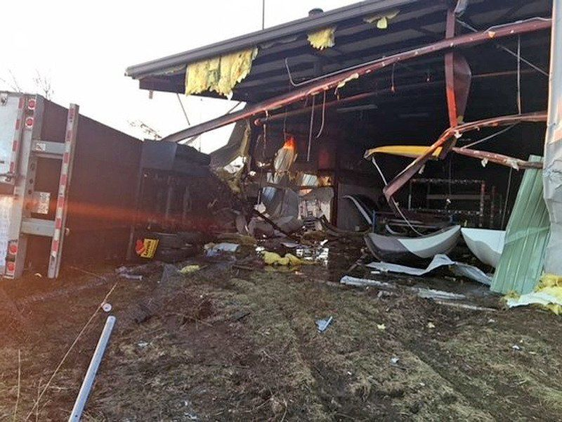 POLICE NEWS: Tractor-trailer smashes through building near Toll Road