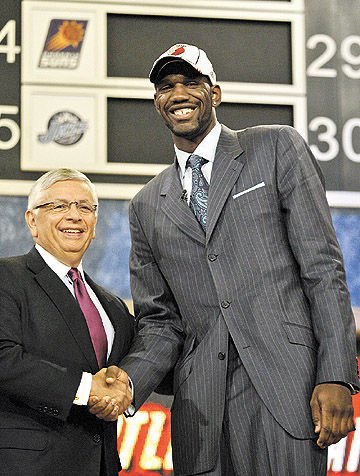 558c1fc9829 Greg Oden of Indianapolis and Ohio State shakes hands with NBA commissioner  David Stern after being selected by the Portland Trail Blazers as the No.