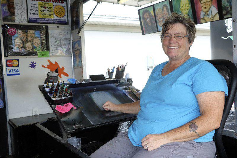 FAIR FACES: Caricaturist makes a living sketching fairgoers | Local ...
