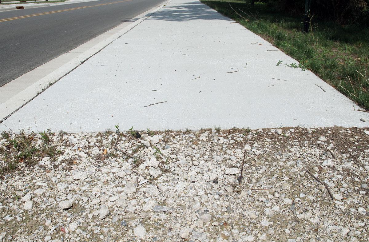 Sidewalk in private yard 22