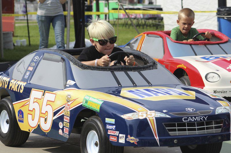 kids race for first place during pedal car event