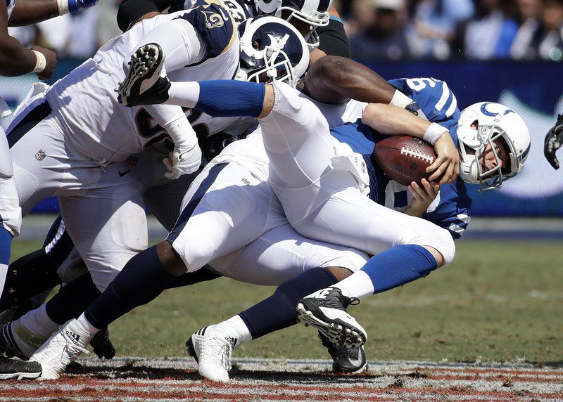 Rams Donald ends holdout, but will not play Sunday against Colts