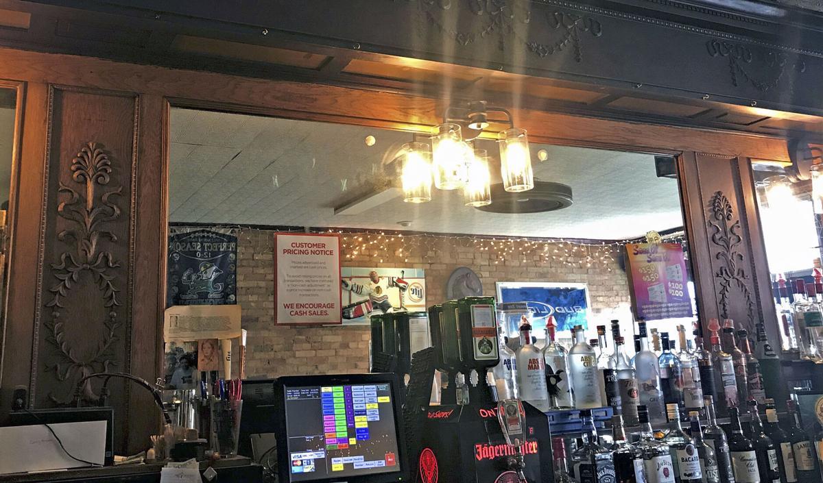 Orignal hardwood bar awaits visitors to Hopple's Bar and Grill.JPG