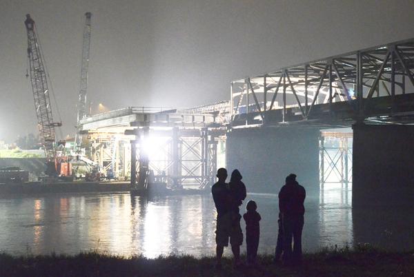 Bridge span moves into place
