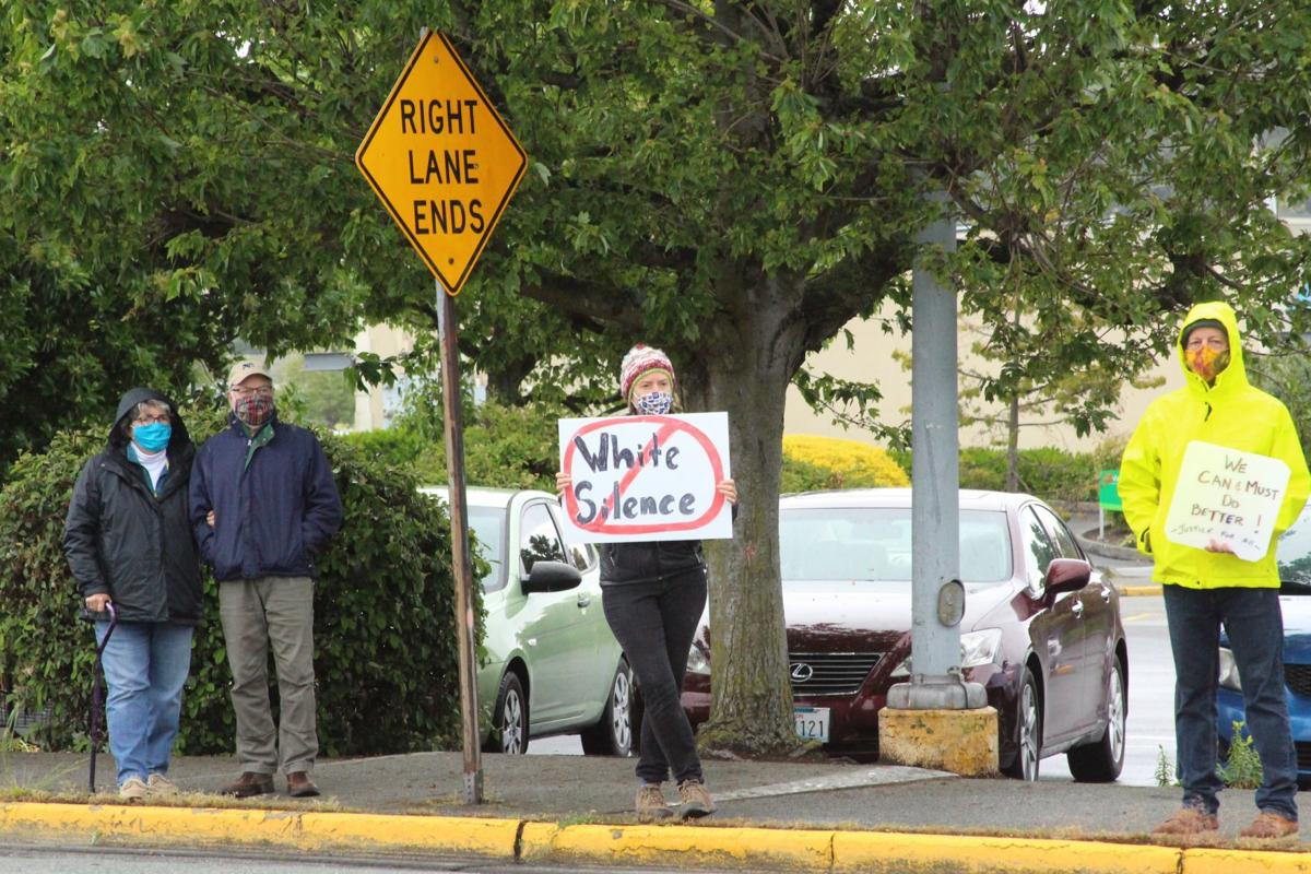 Anacortes protesters gather on Commercial Avenue