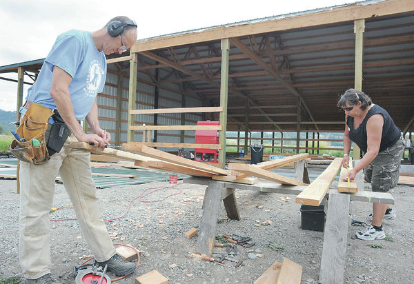 Friends, neighbors help raise new barn at Bow farm after old one lost in fire