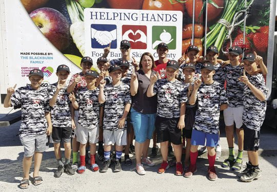 Little League team helps at food bank
