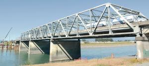 Permanent bridge span goes in Saturday night