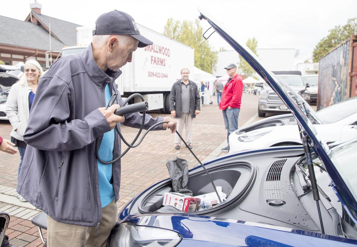 Electric car owners show off vehicles, give rides