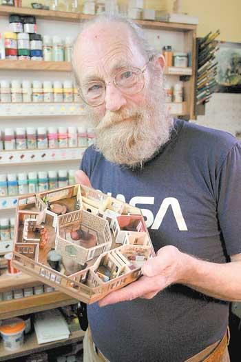 'Caveman' Al works miniature magic