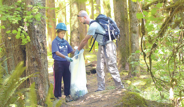 Youths gather for campsite cleanup
