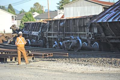 Freight train tips over in Burlington