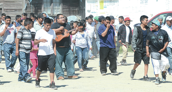 Farm workers strike over wages, treatment