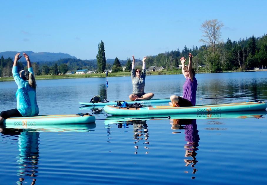 Stand-up paddleboard yoga tests balance, trust