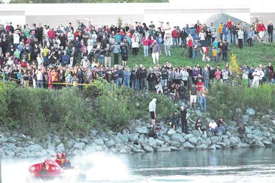 Hundreds gather on river banks after bridge collapse