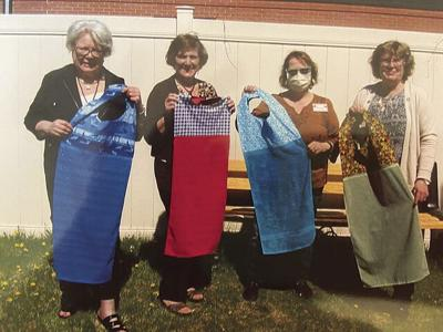 Grand Rapids North Star Women's Club makes and gifts clothing protectors