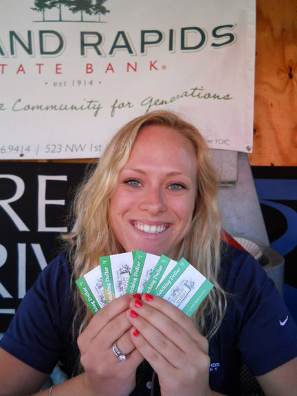 Grand Rapids State Bank intern Sammy Swanson helps distribute the double  Mighty Matching Dollar coupons through Labor Day.