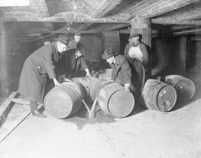 Prohibition agents destroying barrels of alcohol, c. 1921.