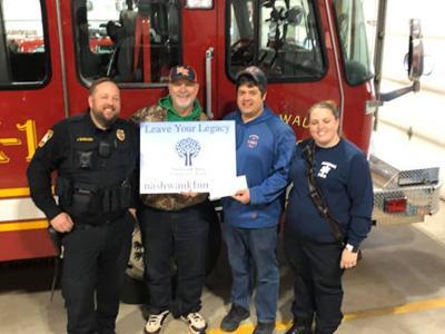 Nashwauk Area Community Fund provides safety vests for Nashwauk Fire Department