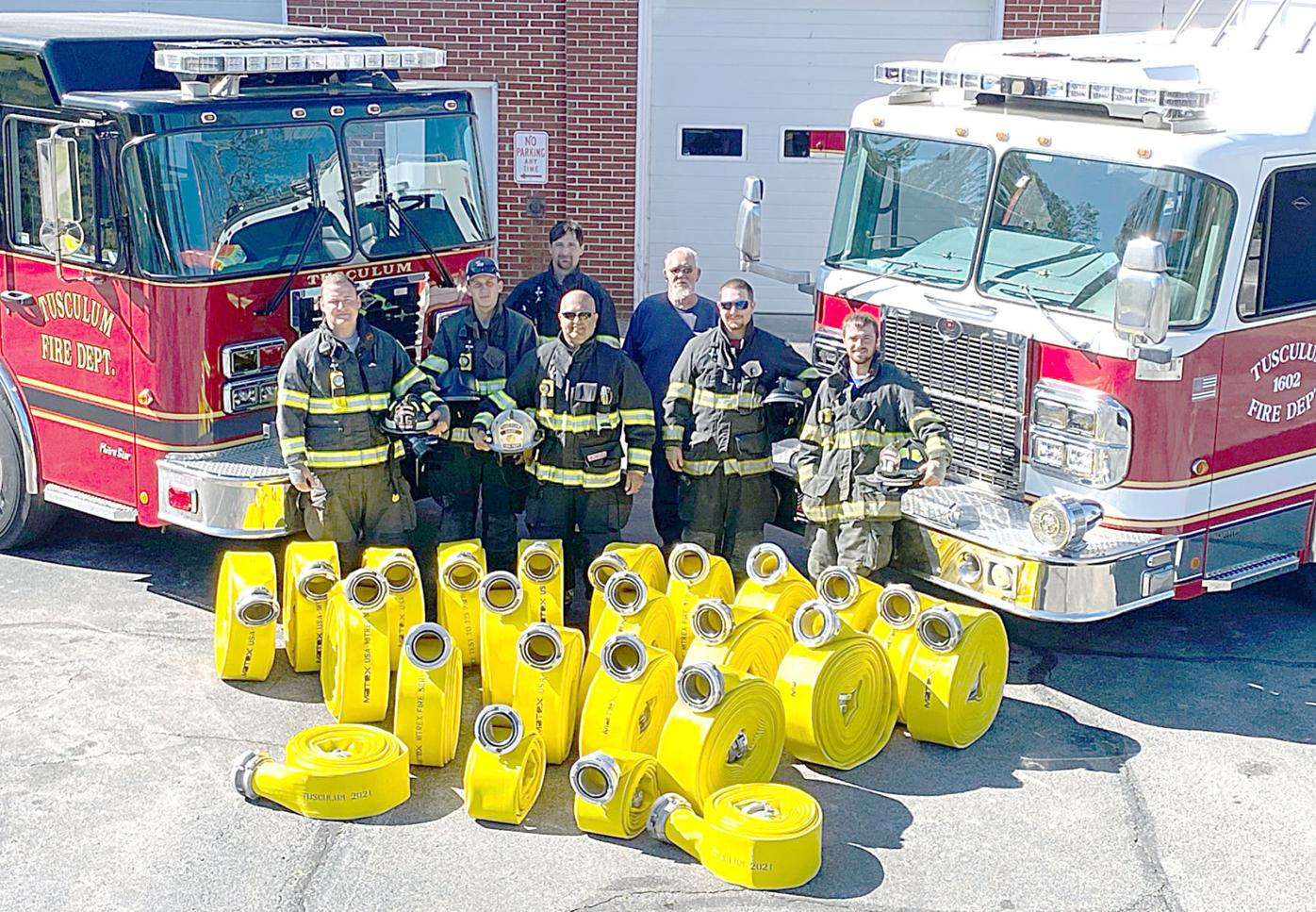 Tusculum FIrefighters With New Fire Hoses