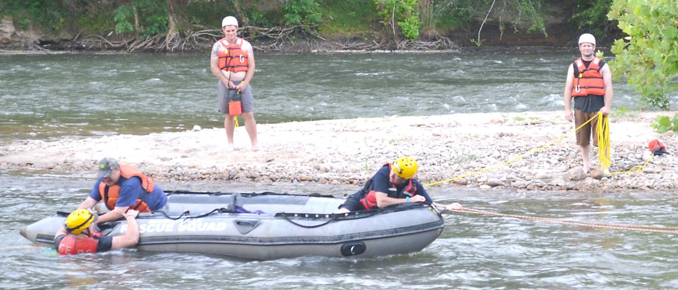 'Victim' Pulled From River Onto Rescue Squad Boat