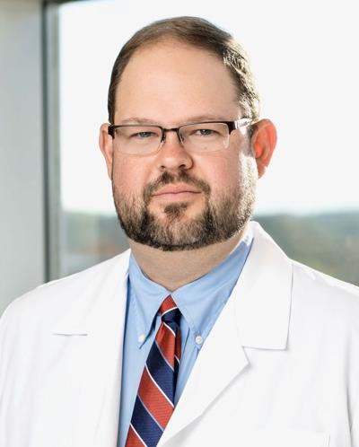 DR. DANIEL LEWIS
