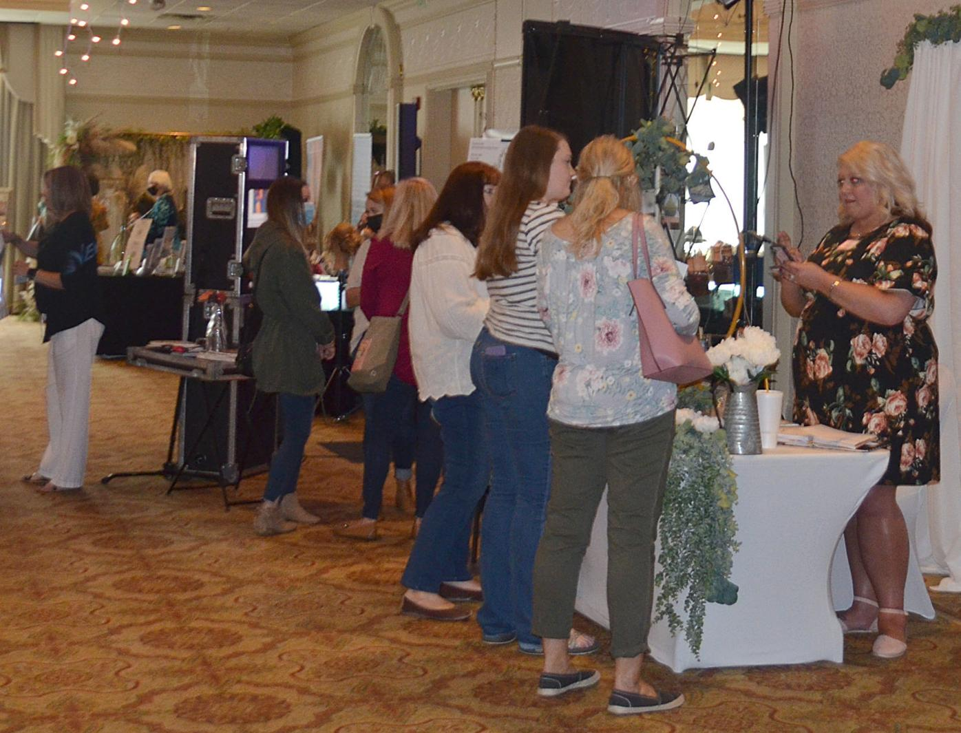 Speaking With Wedding Planner At Bridal Fair