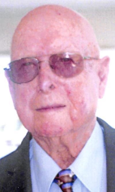 JOHN E. VEST
