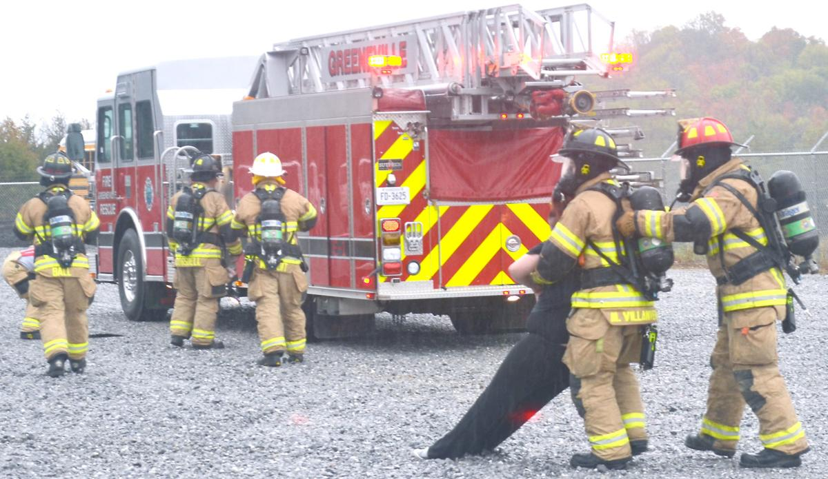 Firefighters Help 'Victim' To Safety During Drill
