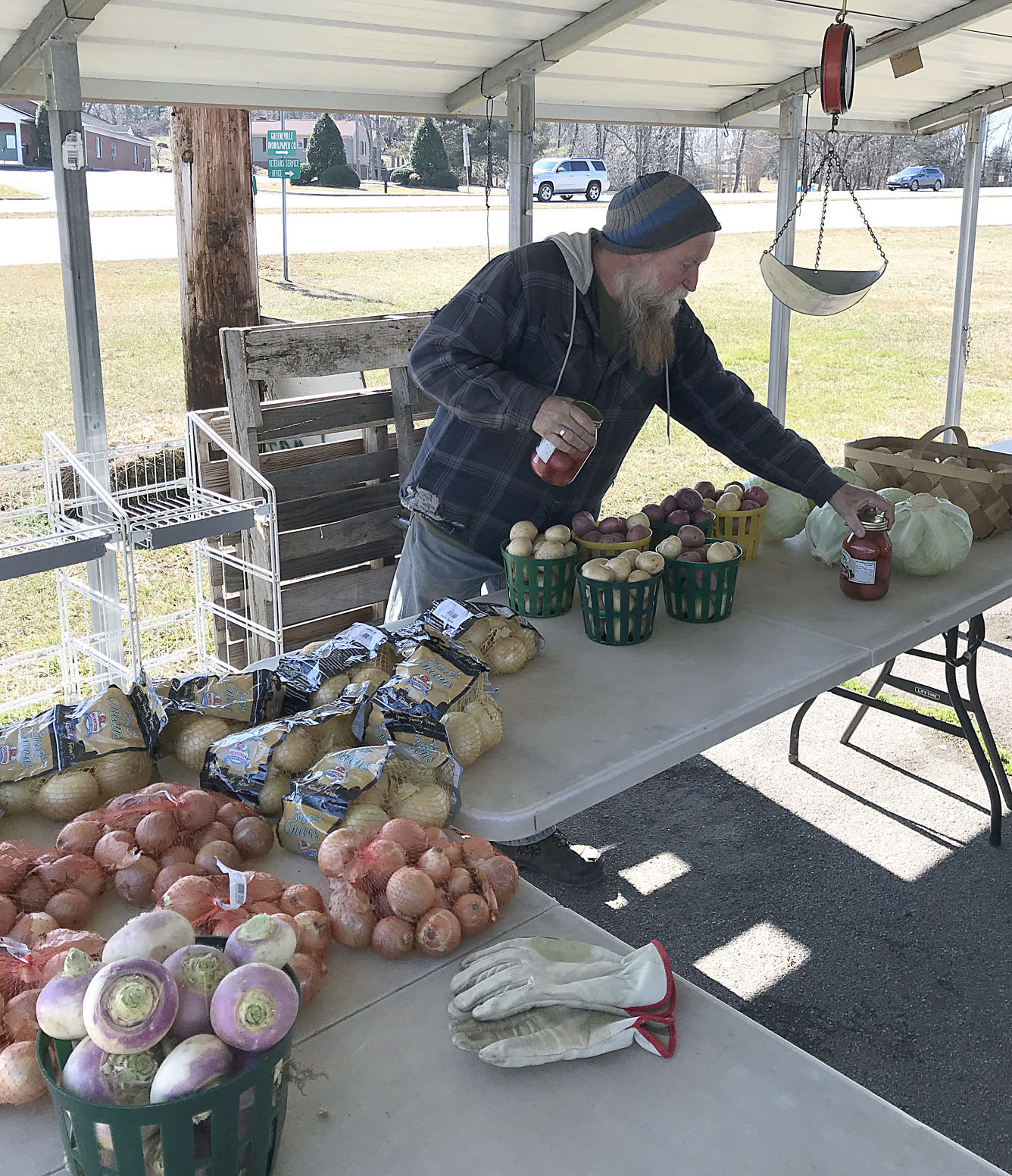 Marcus Key Puts Pickled Eggs Out At Produce Stand