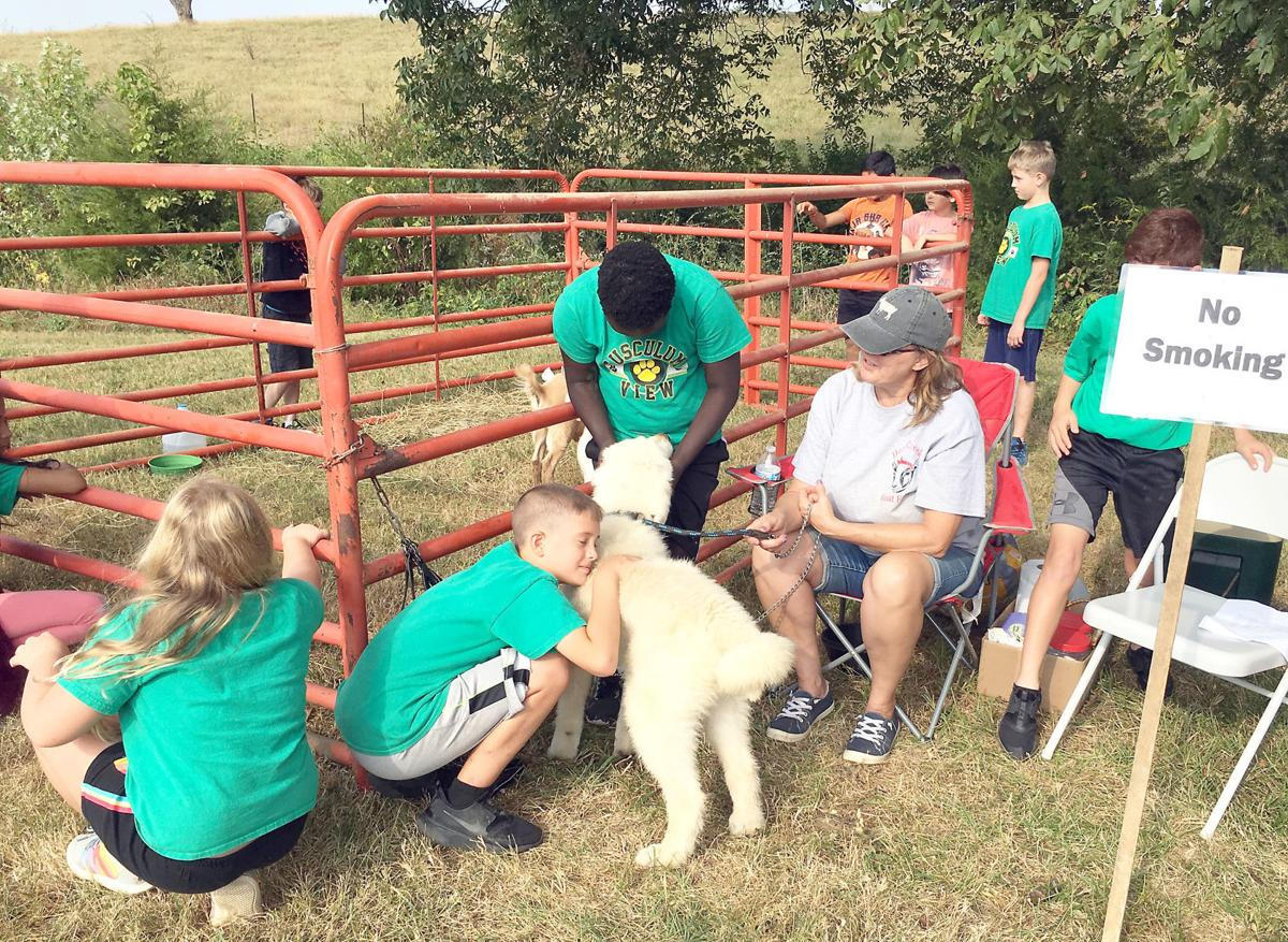 Tusculum View Students With Dog