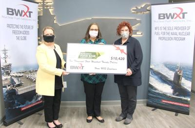 NFS Employees Donate $10,000 To Food Bank