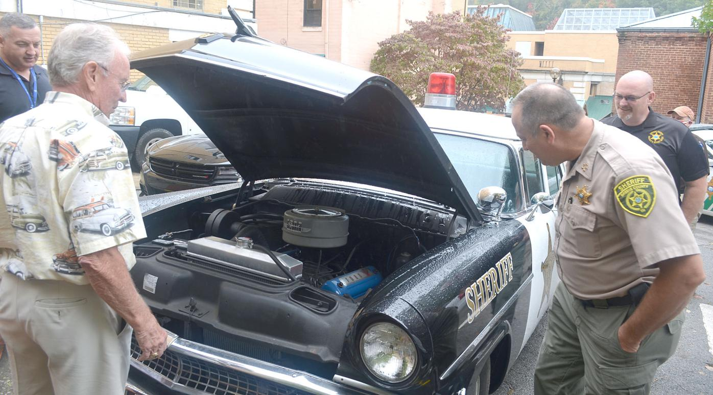 Looking Under The Hood Of '55 Ford Police Car