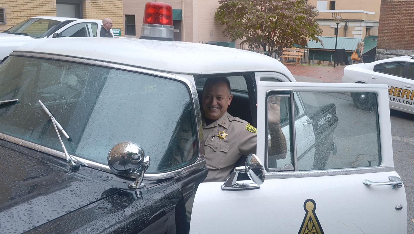 Sheriff Behind The Wheel Of Vintage Patrol Car